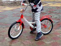 Четырёхколёсный детский велосипед